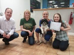A family of happy clients finish group puppy class!
